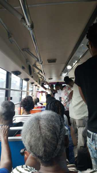 Bus passengers standing in the bus in barbados