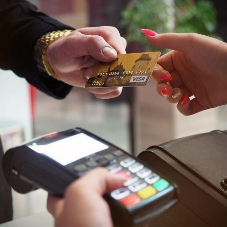 peron offering a credit card to be used on a pos