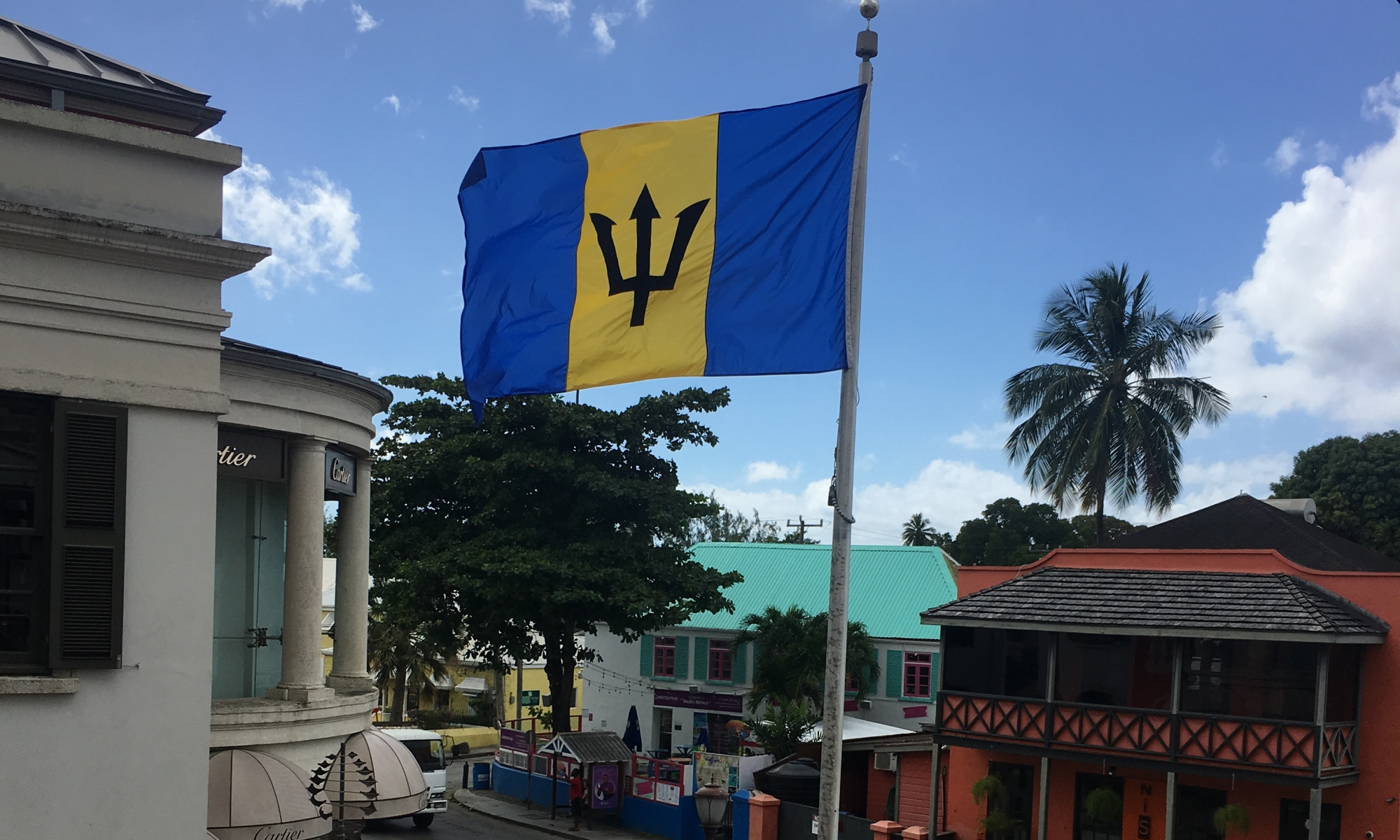 image showing a barbados flag standing next to the street in holetown barbados