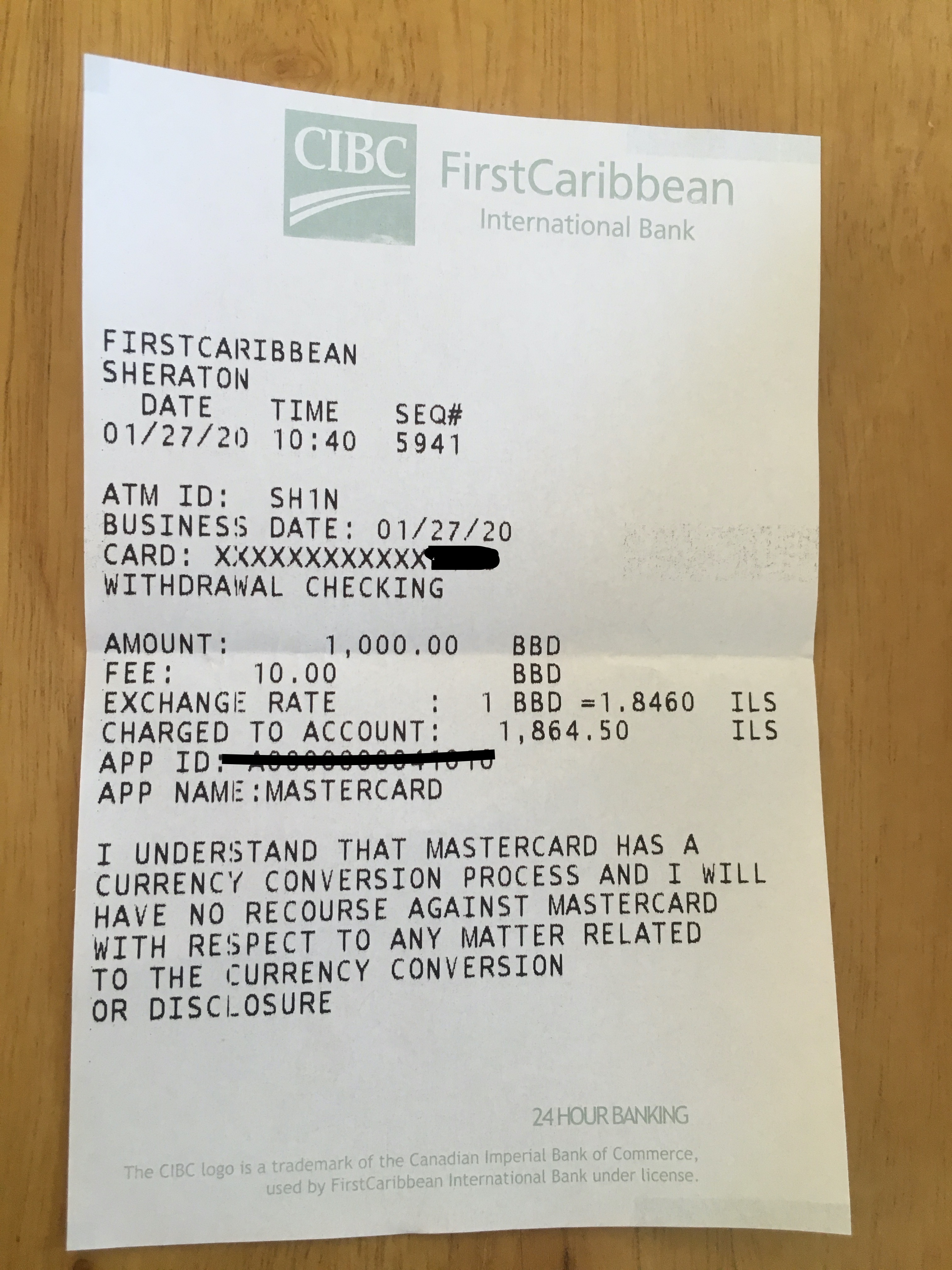 receipt showing ATM withdrawal charges plus exchange rate