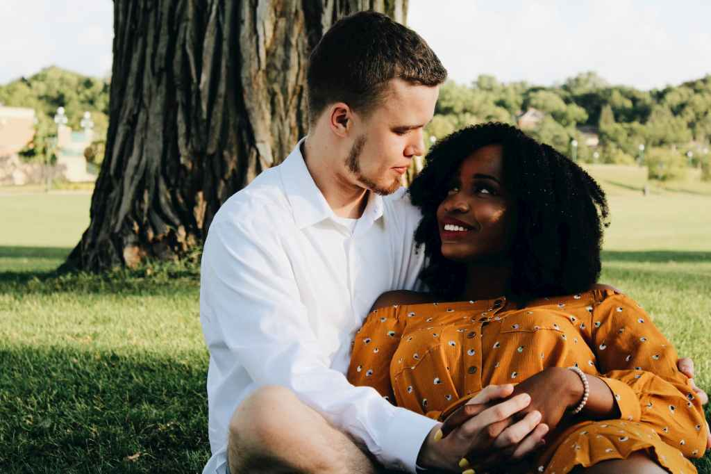 white man in love gazing into black womans eyes